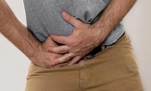 Ноющая и тянущая боль справа внизу живота у мужчин